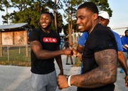Jamel Dean (left) and Chauncey Gardner-Johnson greet each other Thursday at a 2019 NFL Draft party.