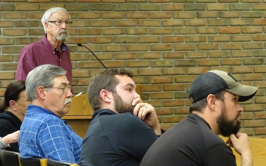 Bob Erwin, at podium, speaks to city council members during a Bucyrus City Council Health and Safety Committee meeting Thursday night.