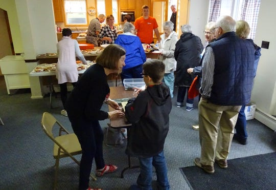 A line forms as a steady stream of diners arrives at the annual pork chop dinner at Mount Zion United Methodist Church on Thursday.