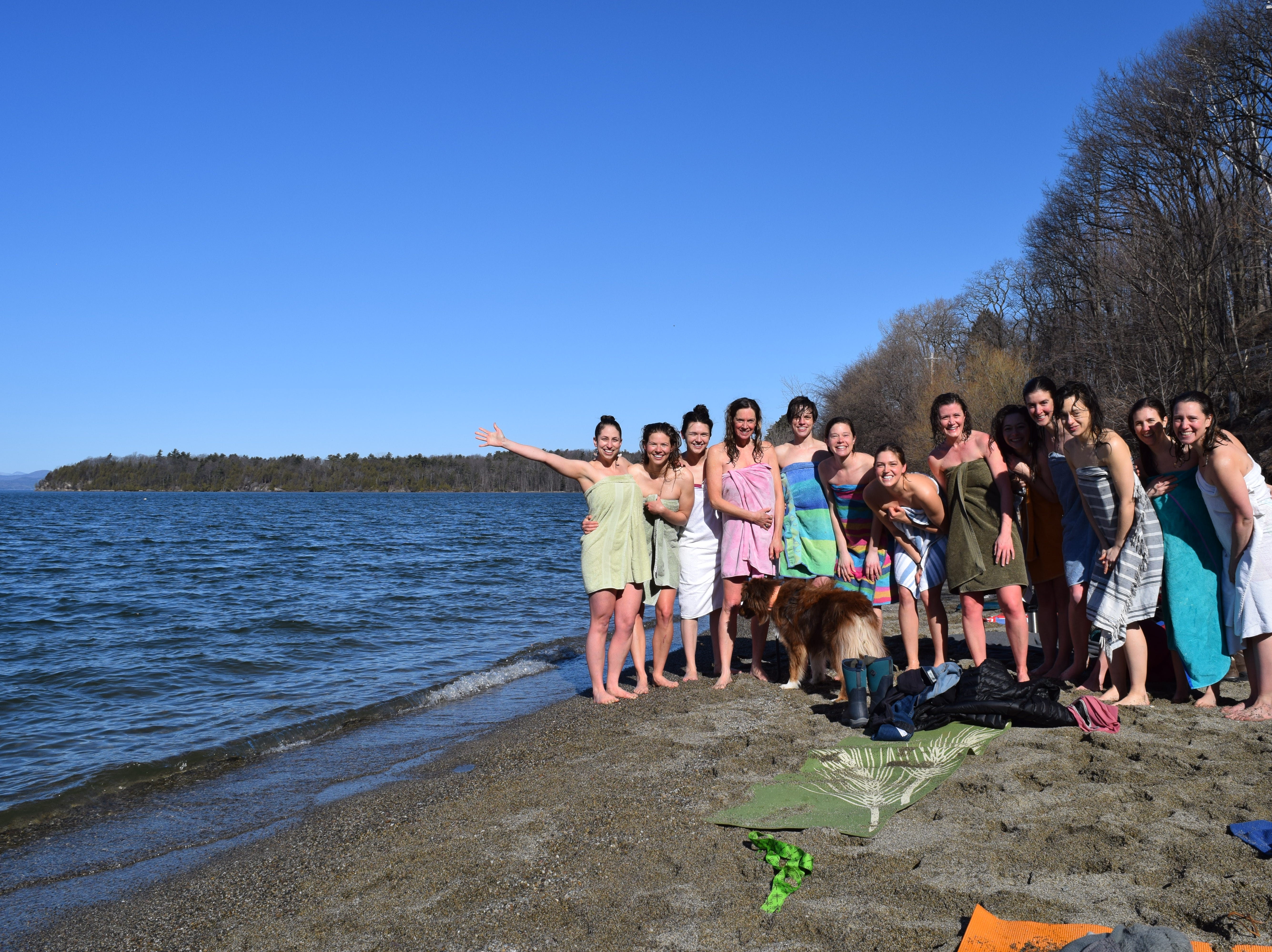 Elise Schadler of Burlington, far left, celebrates her 100th consecutive monthly dip in Lake Champlain with friends at Oakledge Park on April 21, 2018.