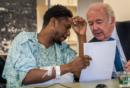 James Felix, 36, of Orlando, Florida, talks with defense attorney Norm Blais during an arraignment hearing held at the University of Vermont Medical Center. The sixth and final suspect in a fatal shooting in the Old North End of Burlington has denied a charge related to the death of city resident Benzel Hampton.