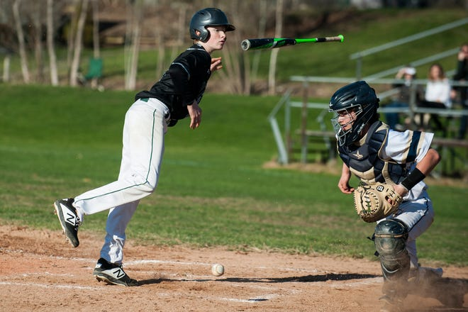 A St. Johnsbury hitter jumps out of the way of a pitch during the baseball game between the St. Johnsbury Hilltoppers and the Essex Hornets at Essex High School on Thursday April 25, 2019 in Essex, Vermont.