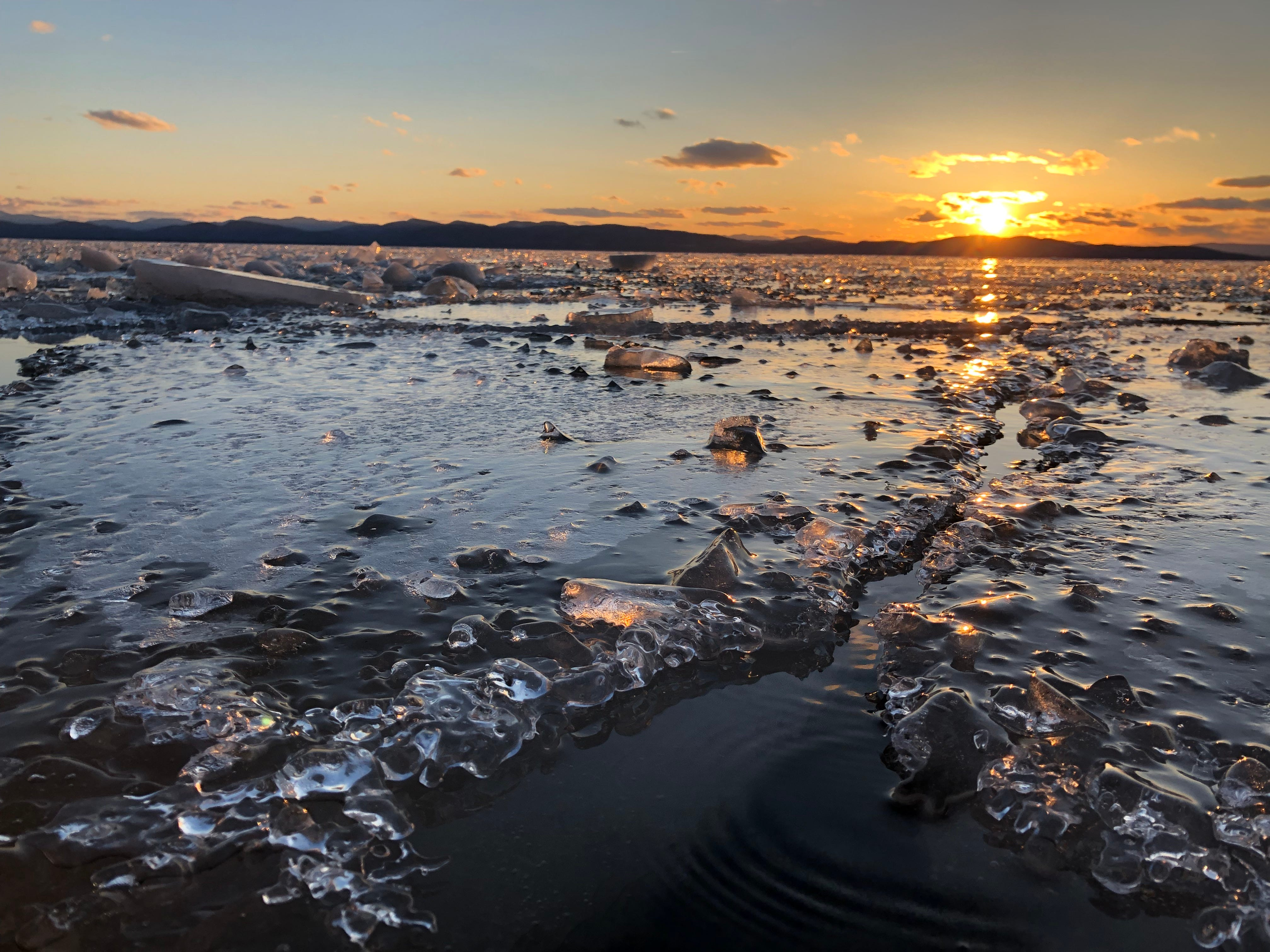 Ground zero: Ice and water greet Burlington artist (and swimmer) Katharine Montstream at a Lake Champlain shoreline April 1, 2019.