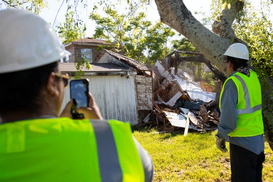 Workers watch as they work to demolish a property in the 1400 block of O'Neill Street in Flour Bluff on Friday, April 26, 2019. This city demolition was funded by Community Development Block Grants.