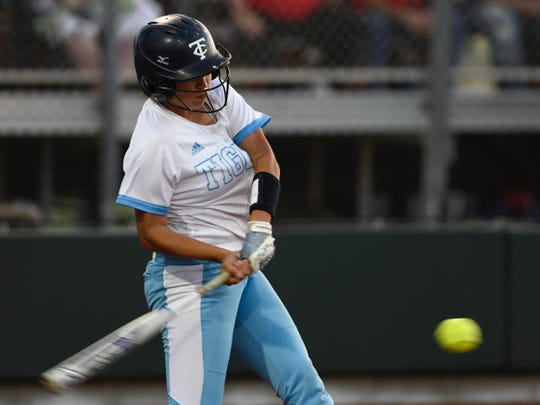 Carroll's Rhea Ann Avalos swings as she hits a grand slam to end the first game of a Class 5A bi-district series with Gregory-Portland at Cabaniss Softball Field on Friday, April 25, 2019.