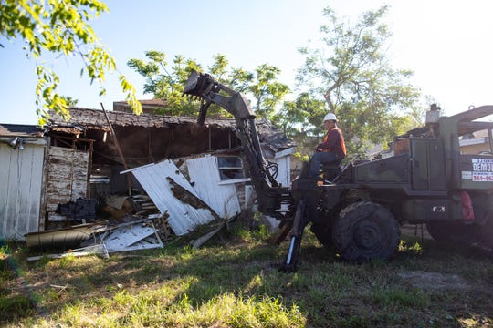 Workers demolish a property in the 1400 block of O'Neill Street in Flour Bluff on Friday, April 26, 2019. This city demolition was funded by Community Development Block Grants.