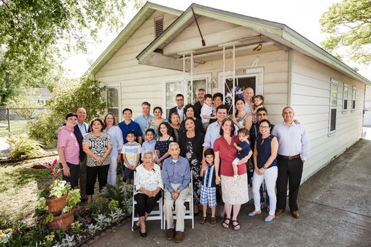 Four generations of the Jimenez family. The photo was taken in front of the family home in Corpus Christi.