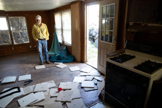 Corpus Christi Council Member Greg Smith stands in a soon to be demolished home in Flour Bluff on Friday, April 26, 2019. This city demolition was funded by Community Development Block Grants.