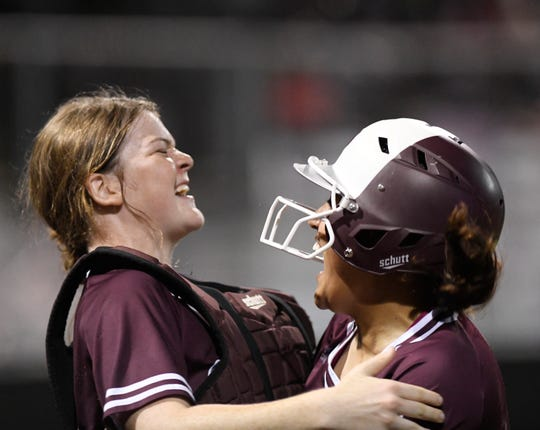 Calallen's Aly Wiggins, left, celebrates the team's three-run lead against Veterans Memorial, Thursday, April 25, 2019, at Cabaniss Softball Field. Calallen won the game, 5-2.
