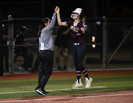 Calallen softball coach Teresa Lentz high fives Raegan Tennill after her three-run home run against Veterans Memorial on Thursday, April 25, 2019.