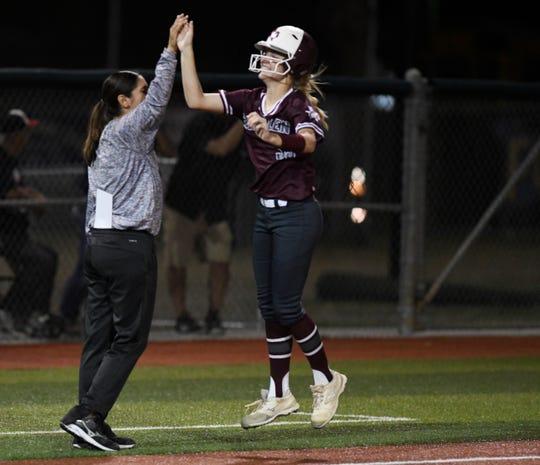 Calallen's Raegan Tennill, right, high-fives her coach Teresa Lentz during the game against Veterans Memorial, Thursday, April 25, 2019, at Cabaniss Softball Field.