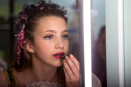 Haeleigh Adams, 13, gets ready backstage to dance in the ballet Dracula put on by the Corpus Christi Ballet at the Selena Auditorium on Friday, April 26, 2019.