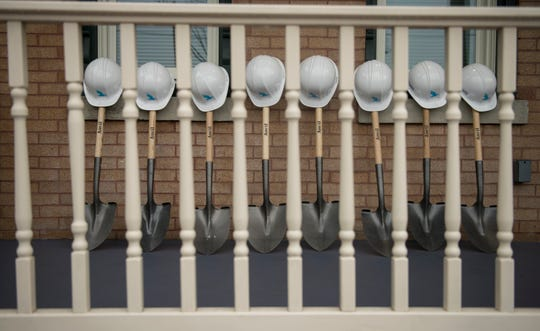 A groundbreaking ceremony took place in front of a renovated unit of the Cooper Plaza Townhomes in Camden on Friday, April 26, 2019, to celebrate the renovation and preservation of the historic affordable housing community.