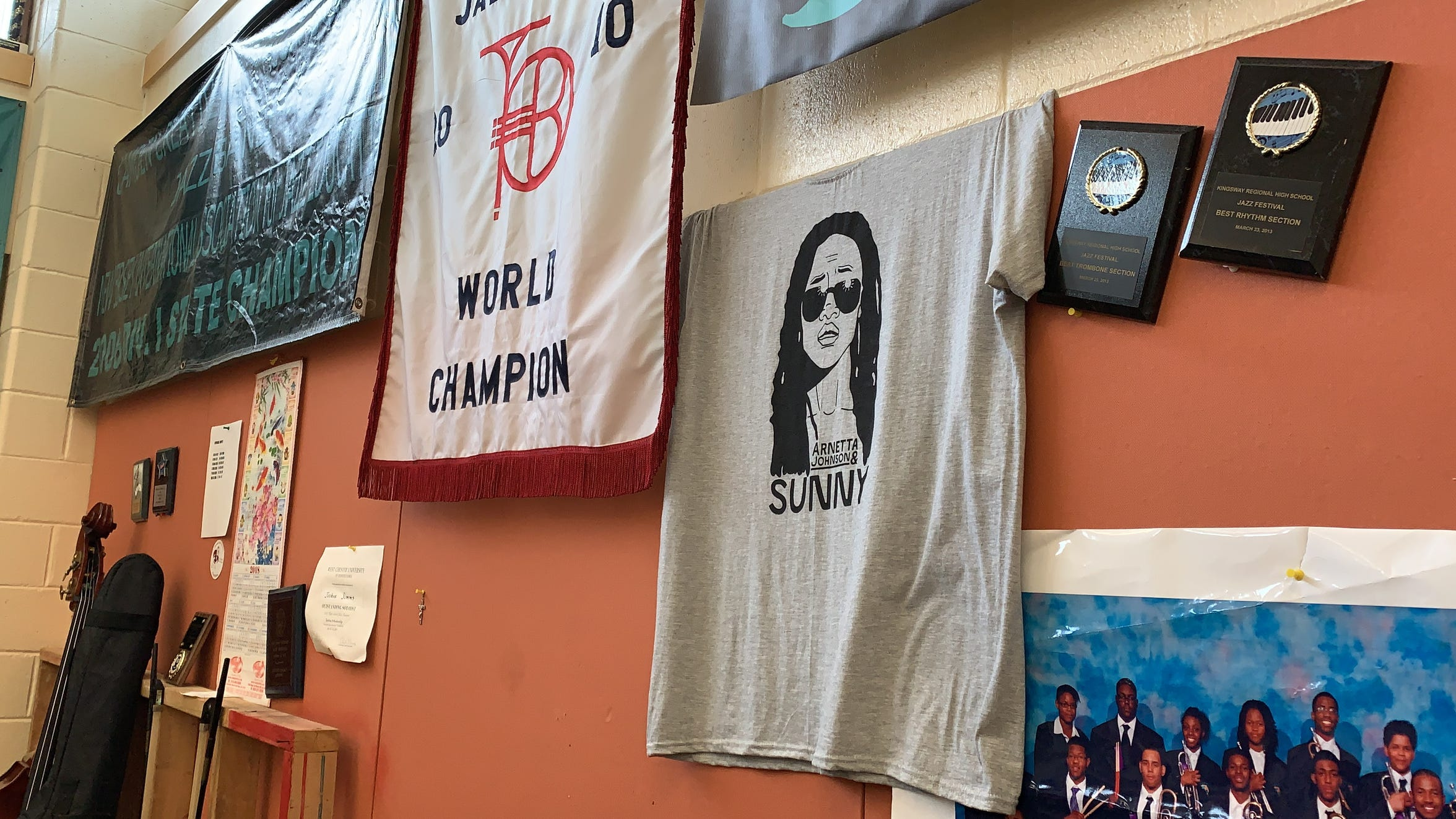 A t-shirt for Creative Arts Morgan Village Academy alumnus Arnetta Johnson's band Arnetta Johnson & Sunny hangs in the high school's band room where she spent countless hours rehearsing.