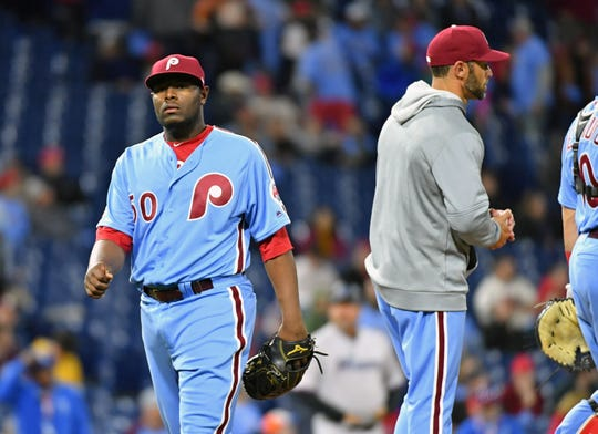 Apr 25, 2019; Philadelphia, PA, USA; Philadelphia Phillies relief pitcher Hector Neris (50) walks off the field against the Miami Marlins after giving up a two run home run during the 10th inning at Citizens Bank Park. Mandatory Credit: Eric Hartline-USA TODAY Sports