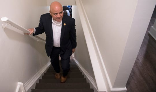 Camden Mayor Frank Moran tours a renovated unit of the Cooper Plaza Townhomes in Camden on Friday, April 26, 2019, following a groundbreaking ceremony held to celebrate the renovation and preservation of the historic affordable housing community.
