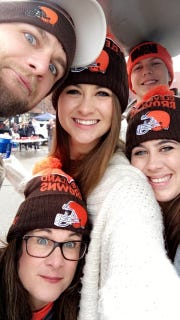 Samantha Elliott poses with friends and family in Cleveland Browns gear. Pictured: Jake Elliott, Jamie Elliott, Samantha Elliott, Chelsea Elliott, and Quentin McKenzie.