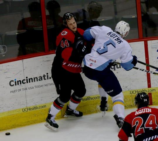 Cyclones Ben Johnson (44) battles  Toledo Walleye defender Brenden  Kotyk during the Kelly Cup playoff game, Thursday, April 25, 2019 at U.S. Bank Arena in downtown Cincinnati.