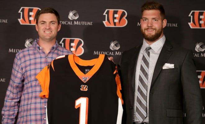 Cincinnati Bengals head coach Zac Taylor, left, introduces 2019 first-round NFL Draft pick, offensive tackle Jonah Williams, on Friday, April 26, 2019, at Paul Brown Stadium in Cincinnati.