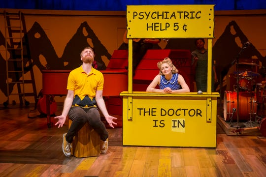 """Charlie Brown (Rob Morrison) and Lucy (Lauren Molina) in one of the many iconic scenes from Charles M. Schulz's """"Peanuts"""" comic strips that is recreated in """"You're a Good Man, Charlie Brown."""" The musical, directed by Bill Fennelly, is running at the Playhouse through May 18."""