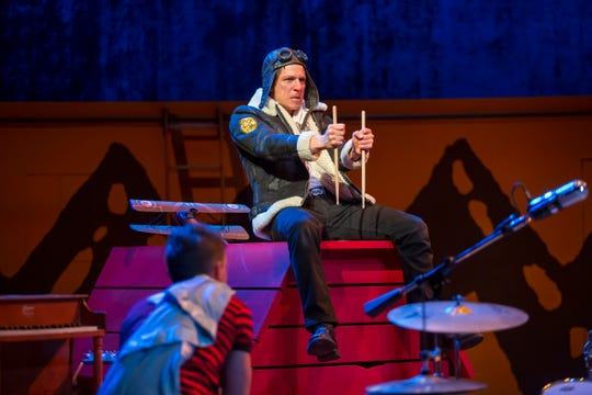 """Snoopy (Armando Gutierrez) with Linus (Nick Cearley, in the foreground) is fantasizing of what it might have been like to be a World War I fighter pilot. It's a scene from the Playhouse in the Park's new production of """"You're a Good Man, Charlie Brown,"""" a 1967 musical inspired by the famed """"Peanuts"""" comic strip. It's a the Playhouse through May 18."""