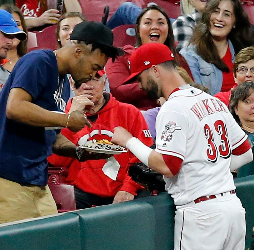 Watch: Cincinnati Reds' Jesse Winker saves a fan's nachos, thinks about sharing