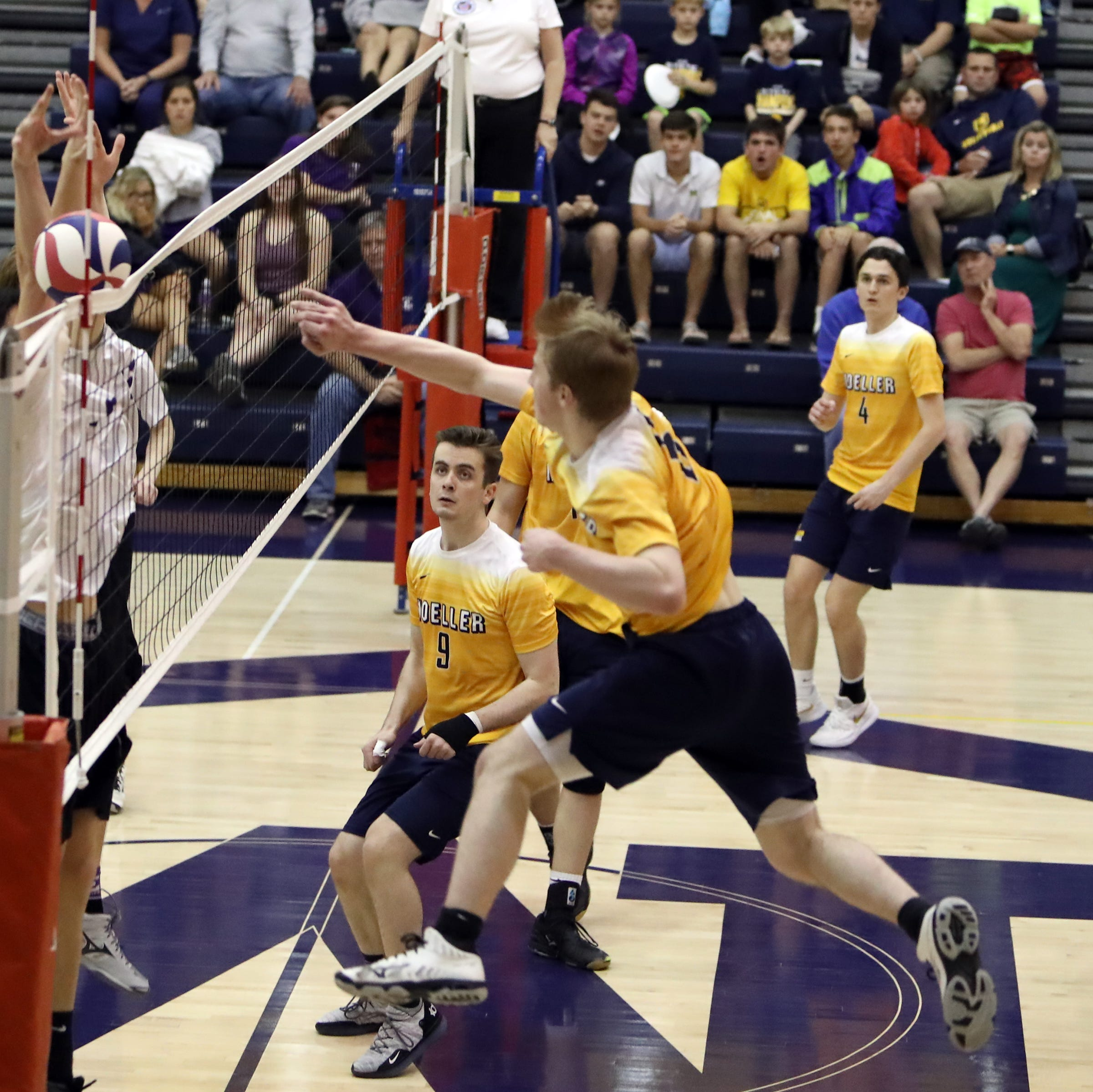 Moeller outside hitter Luke Fuller slams home match point in the match between the Elder Panthers and the Moeller Crusaders at Moeller High School. Moeller defeated Elder 25-18, 26-24, 25-21.