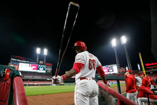 Cincinnati Reds right fielder Yasiel Puig (66) swings his bat in the dugout stairs in the eighth inning of the MLB National League game between the Cincinnati Reds and the Atlanta Braves at Great American Ball Park in downtown Cincinnati on Friday, April 26, 2019. After a long rain delay, the Reds held on to win 4-2.