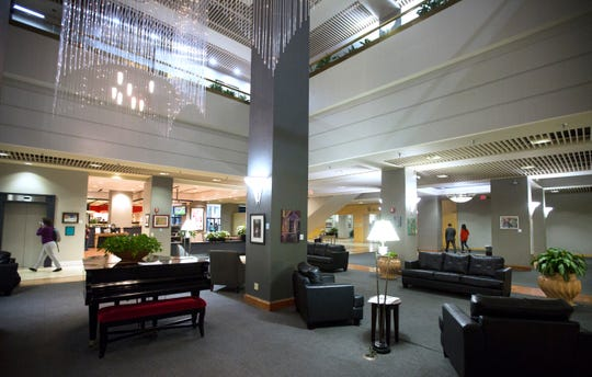 A lounge area on the first floor of the Millennium Hotel in downtown Cincinnati. The hotel, which dates back to the 1960's, is the largest hotel in downtown and boasts 872 rooms. It's attached to the Duke Energy Convention Center by a skywalk, one of the few remaining in the downtown area. Photographed Friday, April 26, 2019.
