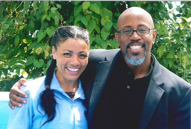 David Singleton, executive director of Beyond Guilt, poses for a picture with Tyra Patterson, one of the people he has worked to get released from prison.
