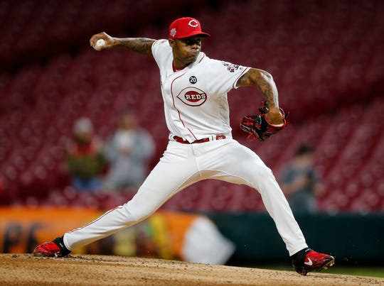 Cincinnati Reds relief pitcher Raisel Iglesias (26) delivers a pitch in the eighth inning of the MLB National League game between the Cincinnati Reds and the Atlanta Braves at Great American Ball Park in downtown Cincinnati on Friday, April 26, 2019. After a long rain delay, the Reds held on to win 4-2.