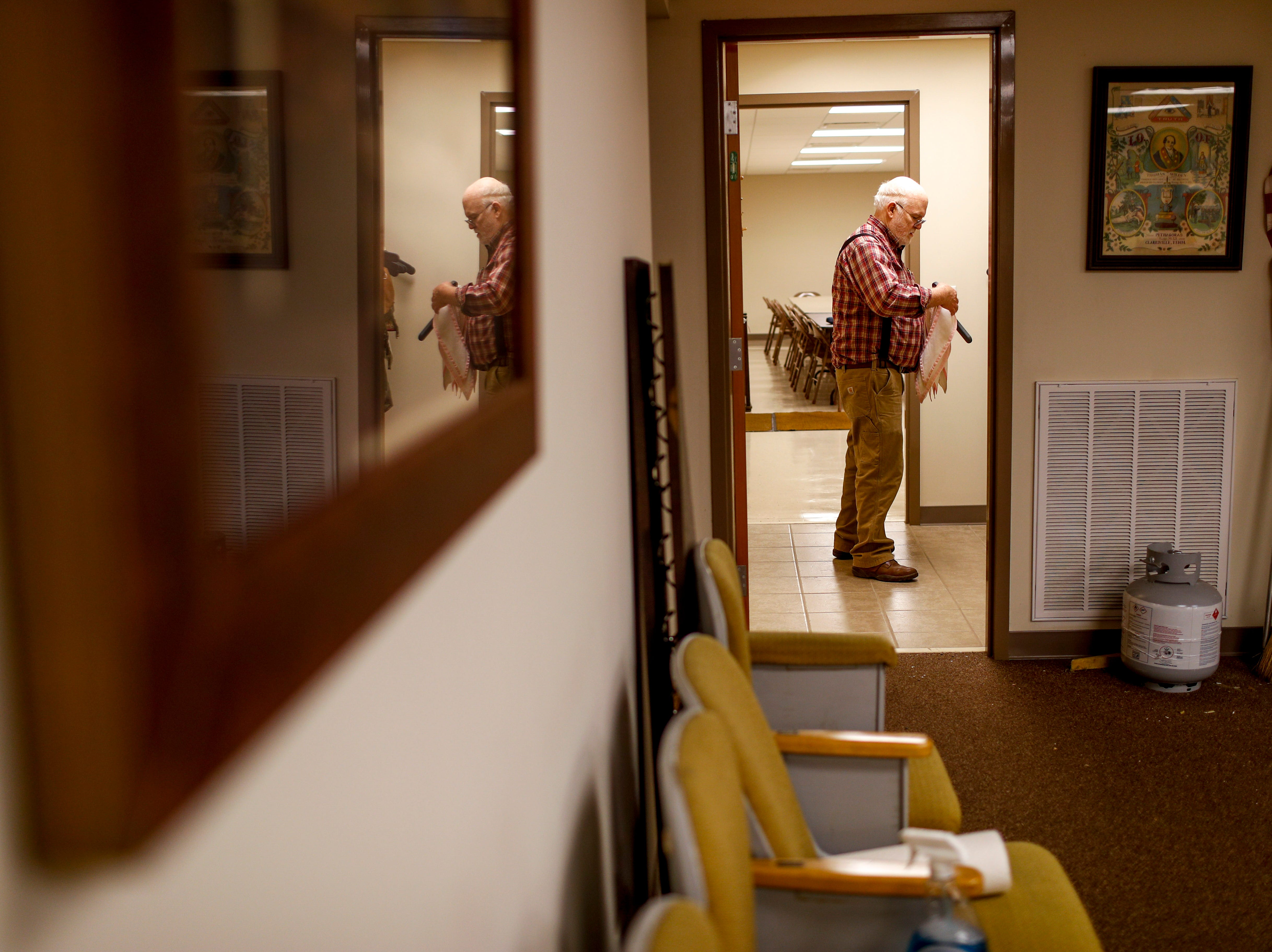 Carl Edwards takes different sashes and hangs them up in a side room at Odd Fellows Lodge in Clarksville, Tenn., on Tuesday, April 23, 2019.