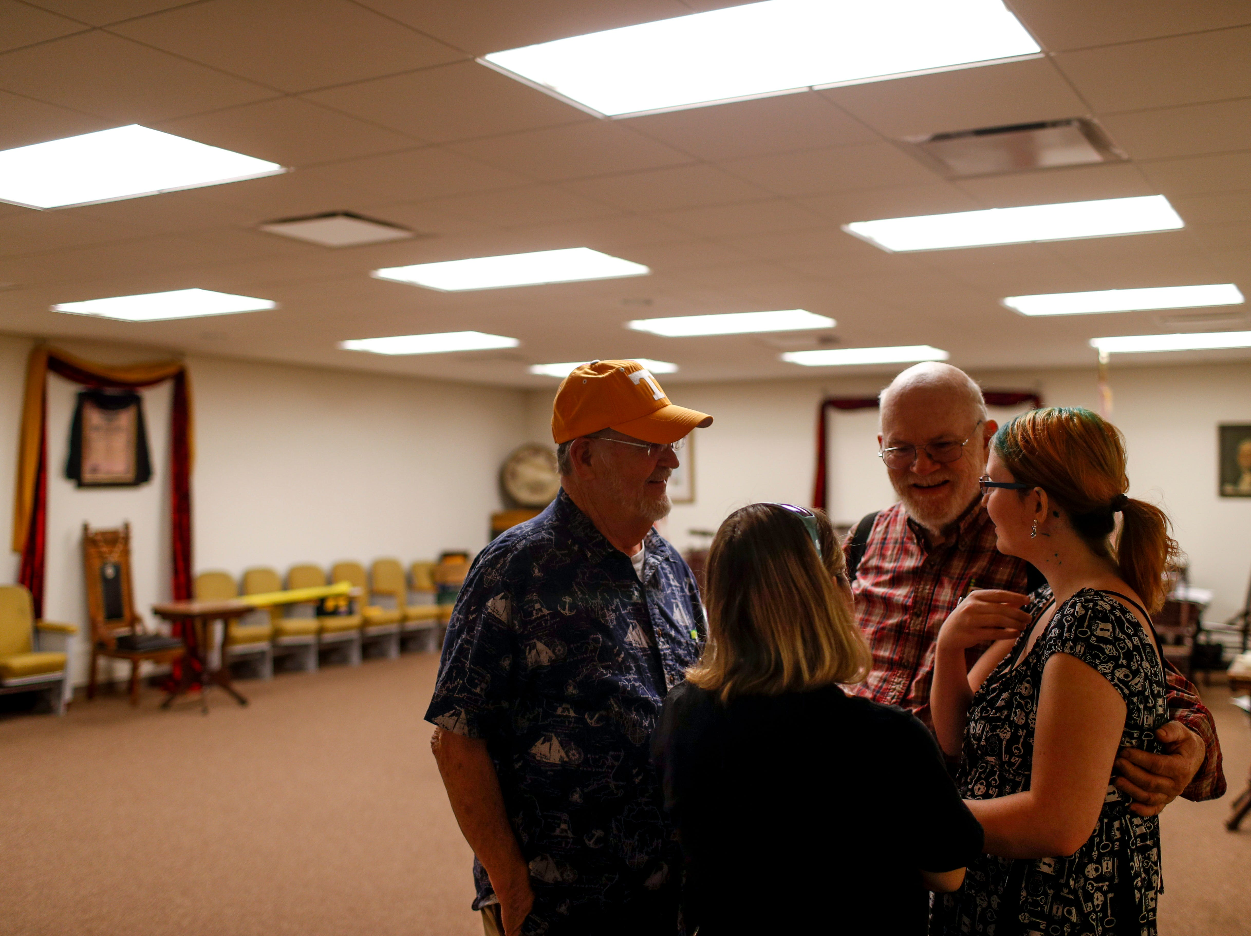 Bobby Haskins and Carl Edwards chat with prospective members of the society at Odd Fellow Lodge in Clarksville, Tenn., on Tuesday, April 23, 2019.