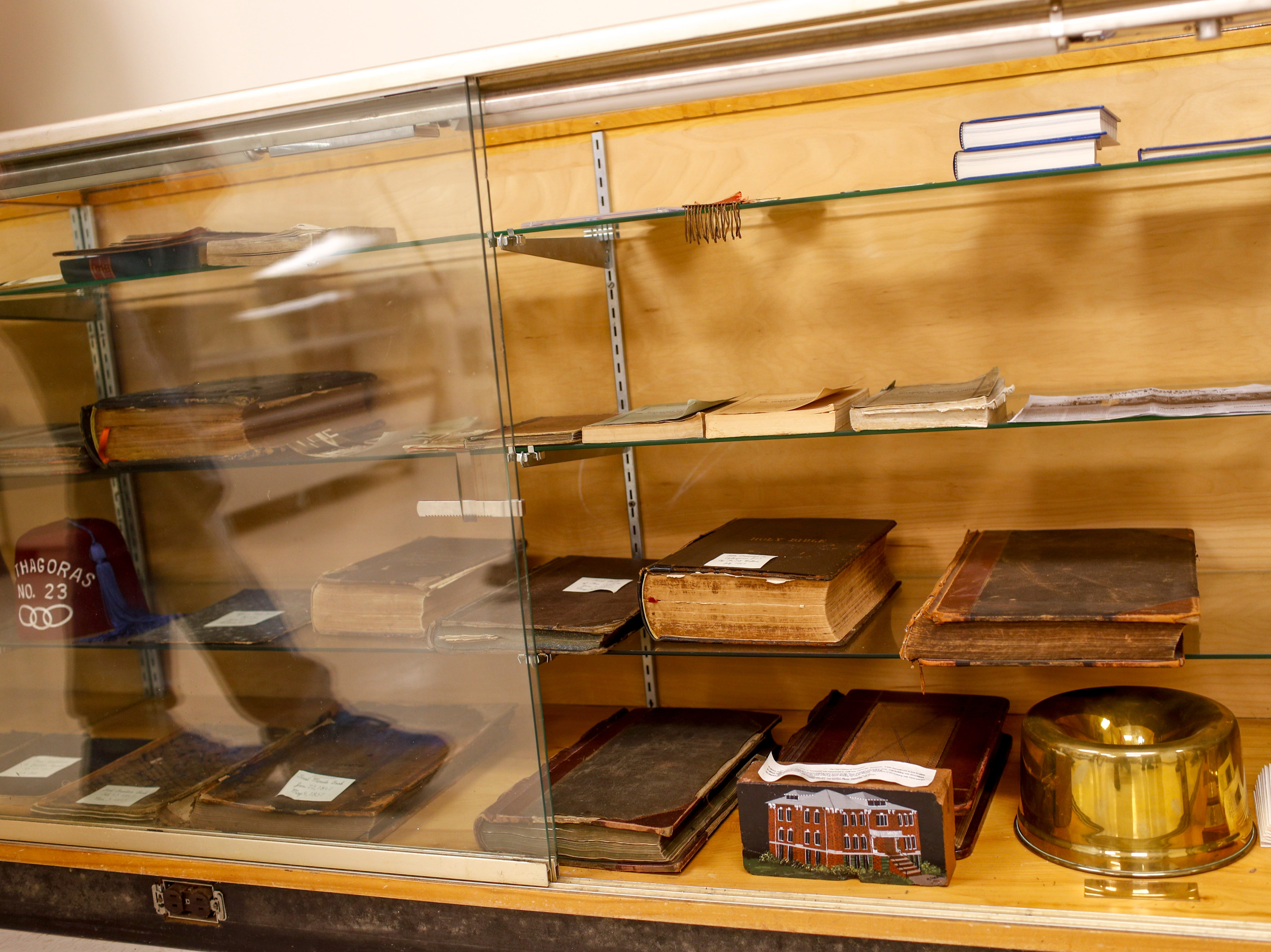 Old documents and historical objects unique to the Clarksville lodge and beyond are on display in a glass cabinet for viewing at Odd Fellow Lodge in Clarksville, Tenn., on Tuesday, April 23, 2019.