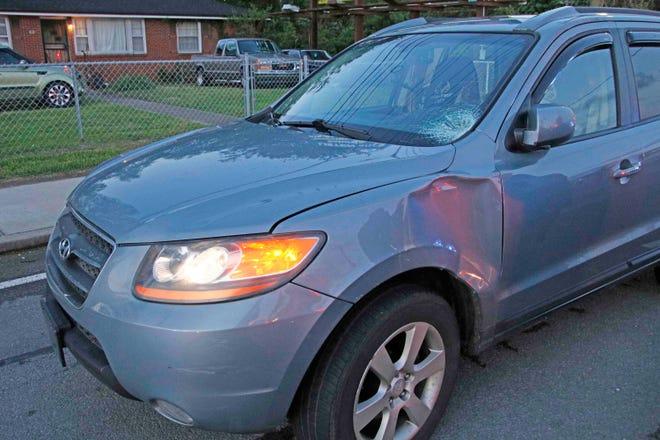 This Hyundai Santa Fe was damaged when a pedestrian ran into it on Providence Boulevard Friday morning, April 26, 2019.