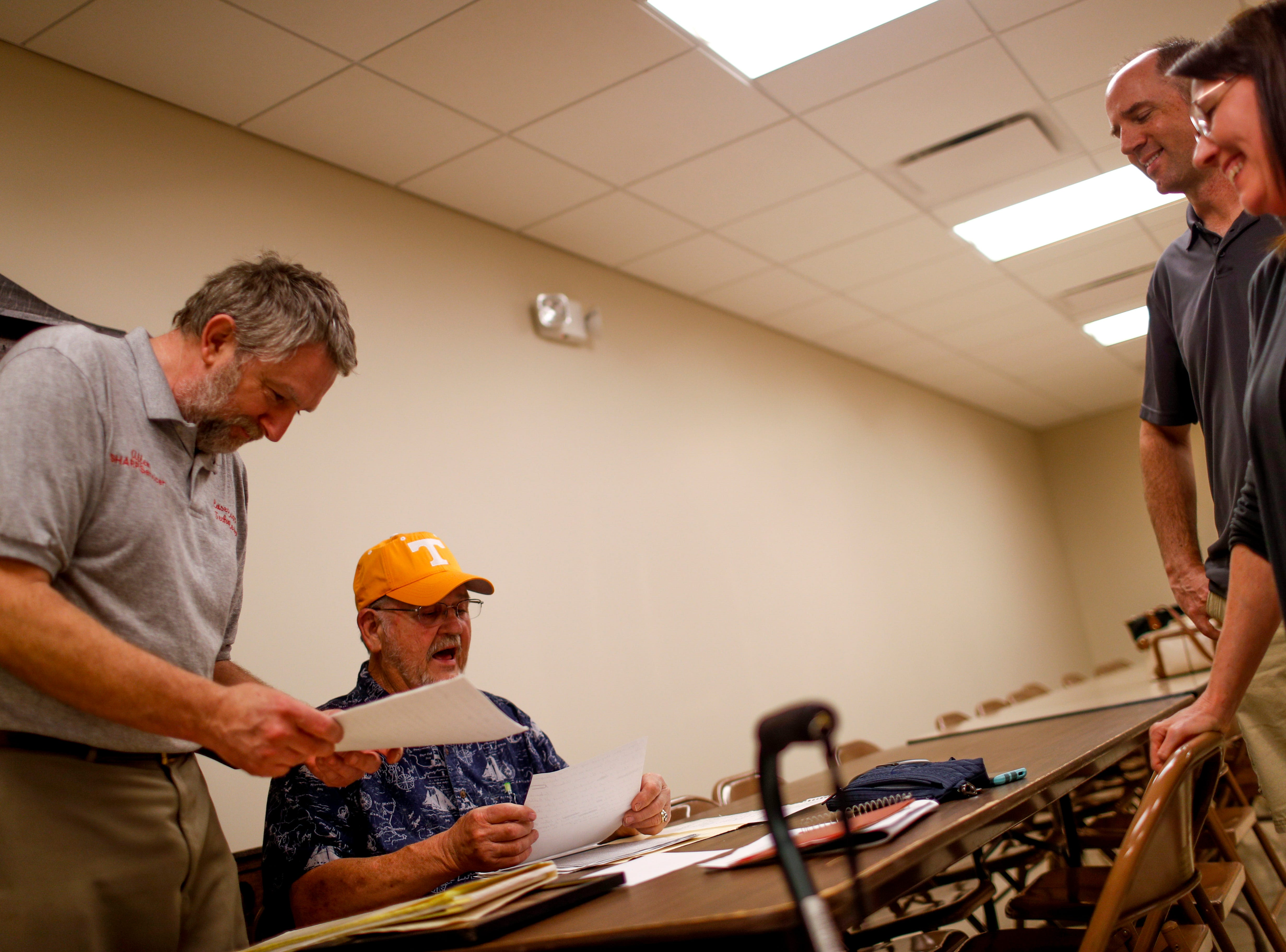 Members go through old documents with Bobby Haskins, center, at Odd Fellow Lodge in Clarksville, Tenn., on Tuesday, April 23, 2019.