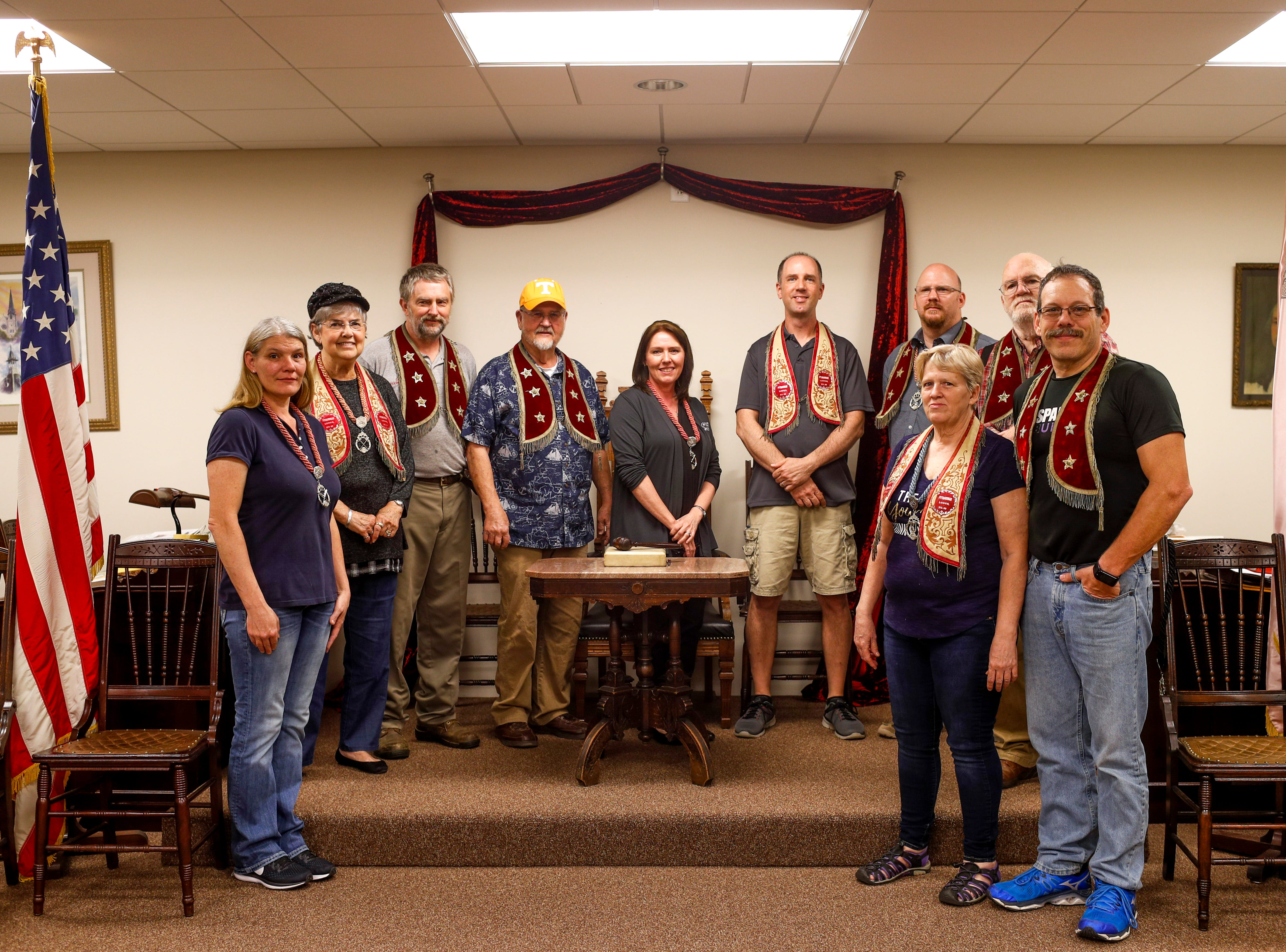 Members of the Clarksville lodge stand in the meeting hall for a portrait at Odd Fellow Lodge in Clarksville, Tenn., on Tuesday, April 23, 2019.