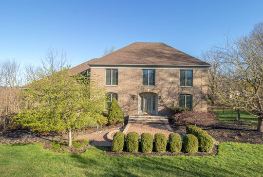 Astately brick front residence set along a cul de sac in Clinton Township is currently for sale for $549,900.