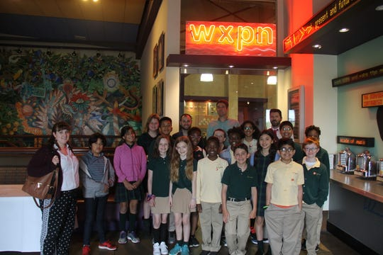 The students and faculty chaperones gather for a group photo outside the WXPN studio.