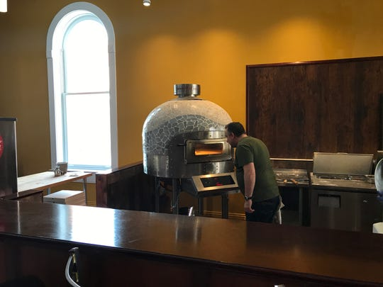 The electric pizza oven with its revolving stone was imported from the Morelli Forni company in Italy