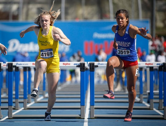Council Bluffs Lincoln's Darby Thomas, right, battles Iowa City West senior Peyton Steva, left, for a win in the 100-meter hurdles during Drake Relays at Drake Stadium in Des Moines on Friday, April 26, 2019.
