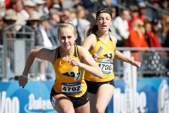 Members of Southeast Polk's sprint medley relay team make the exchange during Drake Relays at Drake Stadium in Des Moines on Friday, April 26, 2019.