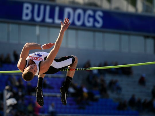 Grant Brouwer from Sibley-Ocheyedan competes in the high jump at the Drake Relays Thursday, April 25, 2019.