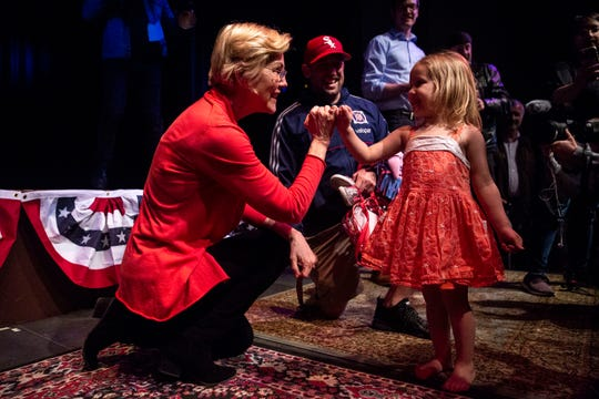 U.S. Sen. Elizabeth Warren, D-Mass., does a pinky swear with three-year-old Emmeline, of Cedar Rapids, during a Linn Phoenix Club meet and greet on Thursday, April 25, 2019, in Cedar Rapids.