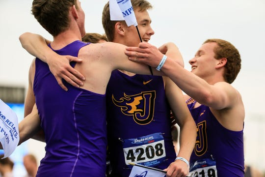 The Johnston boys 4x800 meter relay team celebrates after a win at the Drake Relays Friday, April 26, 2019.Friday, April 26, 2019.