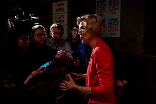 U.S. Sen. Elizabeth Warren, D-Mass., answers questions from the press after speaking at a Linn Phoenix Club meet and greet on Thursday, April 25, 2019, in Cedar Rapids.