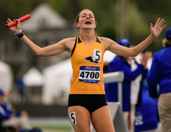 Southeast Polk's Paige Blackford celebrates after anchoring the winning 4x800 meter relay at the Drake Relays.