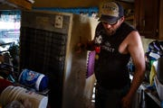 Chris Elben of Osceola helps clean out the flood damaged home of his friends Mary and Danny Manchester on Tuesday, April 16, 2019, in Pacific Junction.