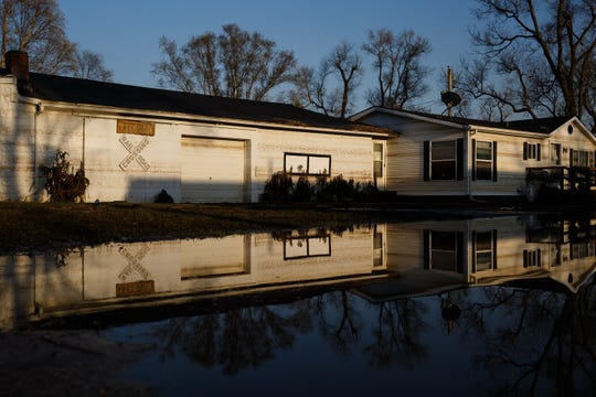 Lines from where the flood waters stopped before receding again can be seen on a home in Pacific Junction on Tuesday, April 16, 2019.