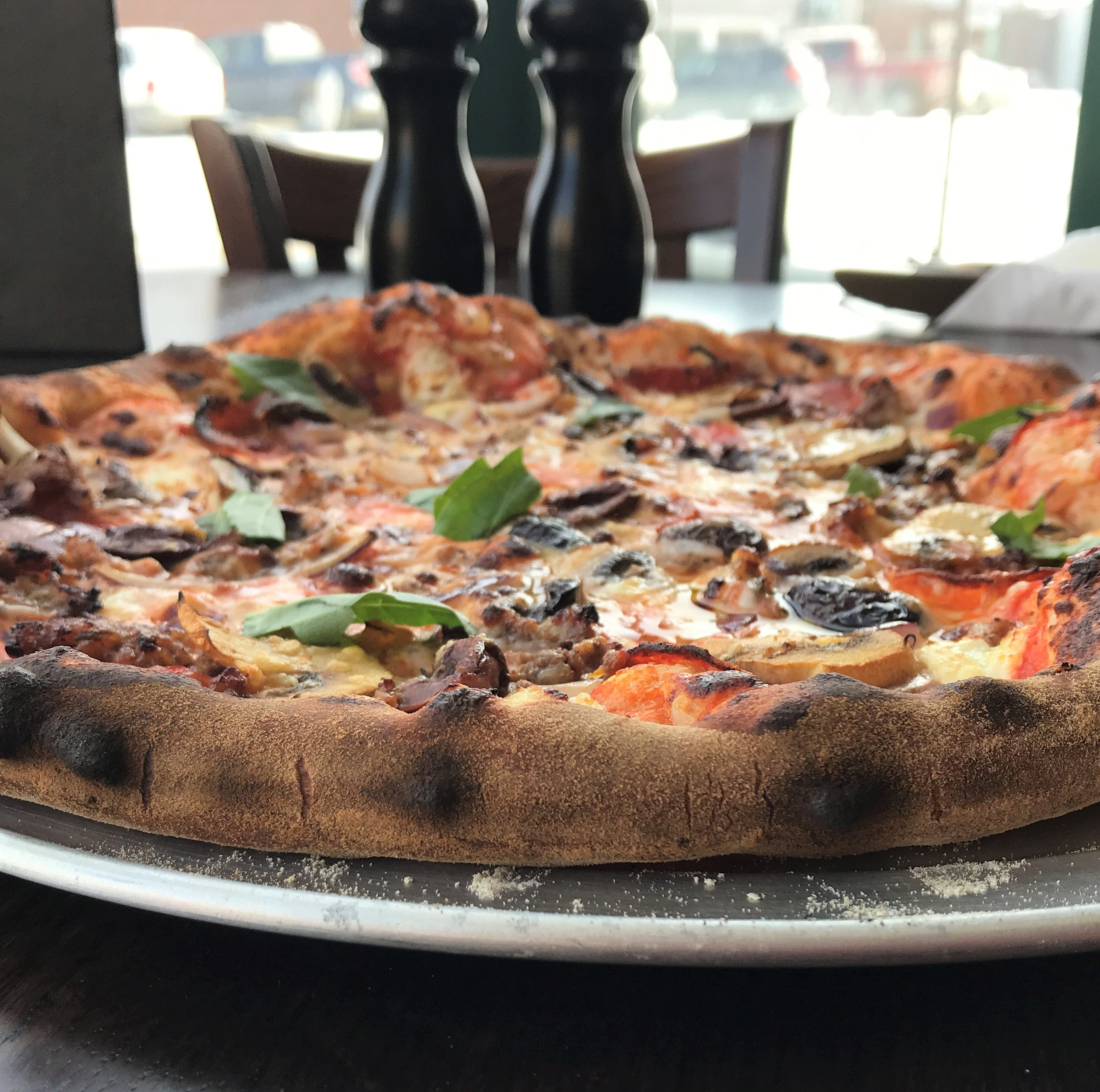 A new pizza restaurant is now open in the historic Bricker-Price Block in Earlham